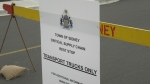 A sign outside the temporary rest stop for truck drivers in Sidney, B.C. (CTV News)