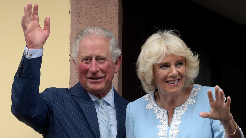 In this Wednesday, May 8, 2019 file photo, Britain's Prince Charles and Camilla, Duchess of Cornwall wave from the town hall balcony in Leipzig, Germany. Prince Charles, the heir to the British throne, has tested positive for the new coronavirus. The prince's Clarence House office reported on Wednesday, March 25, 2020 that the 71-year-old is showing mild symptoms of COVID-19 and is self-isolating at a royal estate in Scotland. It says his wife Camilla has tested negative. (AP Photo/Jens Meyer, File)