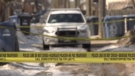 A police car remains on scene in the 200 block of Landsdowne Avenue on Thursday. Police have arrested and charged two women with second degree murder after a man's body was found in a garbage bin (CTV News file)