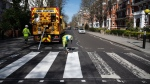 A Highways Maintenance team takes advantage of the COVID-19 coronavirus lockdown to re-paint the iconic Abbey Road crossing in London. (Leon Neal/Getty Images/CNN)