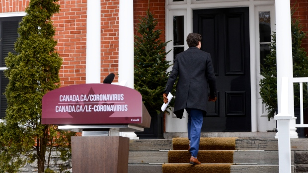 Prime Minister Justin Trudeau leaves after addressing Canadians on the COVID-19 pandemic from Rideau Cottage in Ottawa on Thursday, March 26, 2020. THE CANADIAN PRESS/Sean Kilpatrick