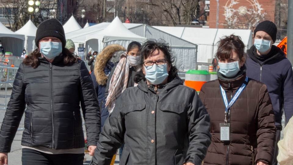 People wear masks as they leave the COVID-19 testi