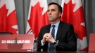 Minister of Finance Bill Morneau listens to a question at a press conference on COVID-19 at West Block on Parliament Hill in Ottawa, on Wednesday, March 25, 2020. THE CANADIAN PRESS/Justin Tang