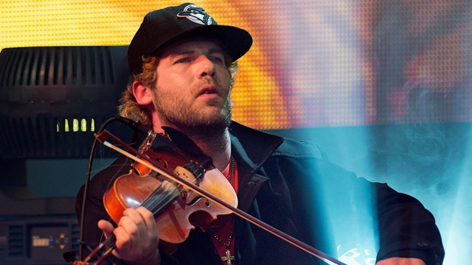 Fiddler Ashley MacIsaac plays at the East Coast Music Awards in Halifax on March 10, 2013. (THE CANADIAN PRESS/Andrew Vaughan)