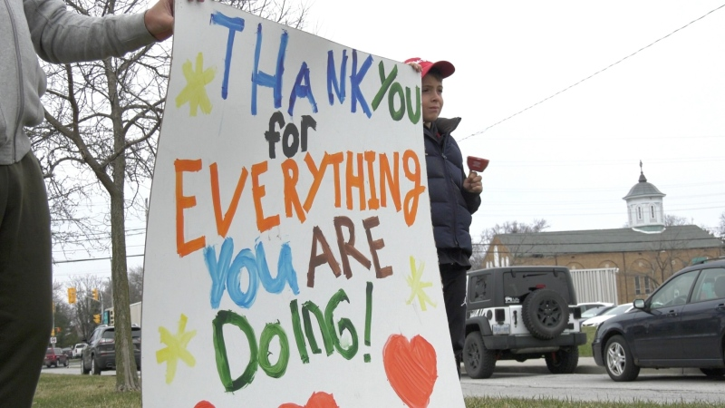 Residents thanks health care workers for their efforts in responding to the COVID-19 pandemic on Friday, March 27, 2020 outside of the Metropolitan Campus of Windsor Regional Hospital. (Ricardo Veneza / CTV Windsor)