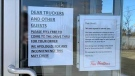 Tim Hortons in Alliston posts a sign in its windows that it is drive-thru only. (CTV News)