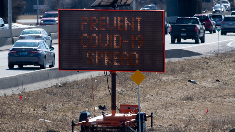 Cars drive along the highway as a sign reminds drivers to stay vigilant about the COVID-19 virus in Ottawa, Friday, March 27, 2020. THE CANADIAN PRESS/Adrian Wyld