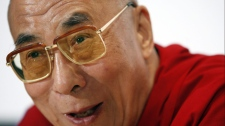 The Dalai Lama laughs while answering a question at a news conference Wednesday, Sept. 23, 2009, in Memphis, Tenn. (AP / Mark Humphrey)