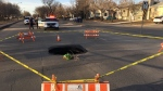 A sinkhole opened up on McCarthy Blvd. on March 27, 2020, forcing crews to close down part of the road. (Gareth Dillistone/CTV News)