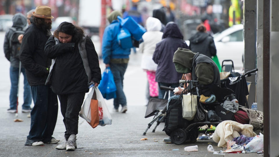 People are seen in Vancouver's Downtown Eastside on Thursday, March 26, 2020. THE CANADIAN PRESS/Jonathan Hayward