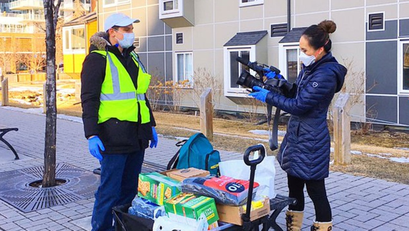 CTV Calgary anchor/videojournalist Kathy Le conducts an interview in protective gear on March 27, 2020.