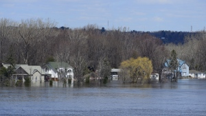 Homes along the Ottawa River in Gatineau, Que. are flooded on Tuesday, April 30, 2019. THE CANADIAN PRESS/Sean Kilpatrick