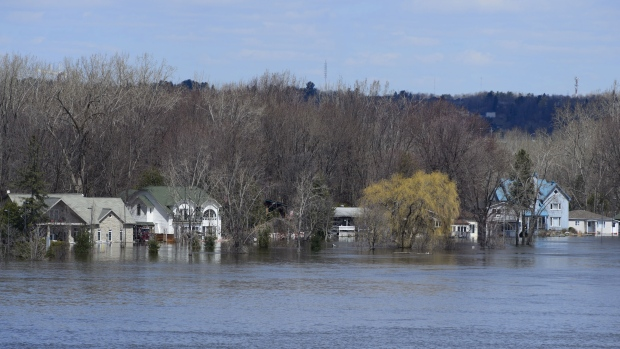 Regions brace to fight rising flood waters and cases of COVID-19