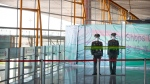 Chinese paramilitary police wear face masks and goggles as they stand guard behind a screen at Beijing Capital International Airport in Beijing, Saturday, March 28, 2020. China's Ministry of Foreign Affairs announced late Thursday that nearly all foreign nationals - including residence permit-holders - will be barred from entering China starting on Saturday amid a worldwide outbreak of coronavirus. The new coronavirus causes mild or moderate symptoms for most people, but for some, especially older adults and people with existing health problems, it can cause more severe illness or death. (AP Photo/Mark Schiefelbein)