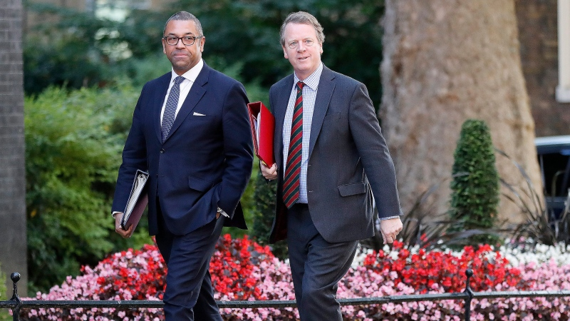 In this file photo, Britain's Secretary of State for Scotland Alister Jack, right, and Party Chairman James Cleverly arrive for a Cabinet meeting at 10 Downing Street in London, Thursday, July 25, 2019. Jack said this week that he is experiencing symptoms of COVID-19 and is self-isolating. (AP Photo/Frank Augstein)