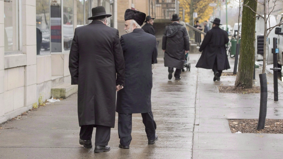 Hasidic Jewish men walk along Bernard Ave. in Outremont, in Montreal. (File photo: THE CANADIAN PRESS/Ryan Remiorz)