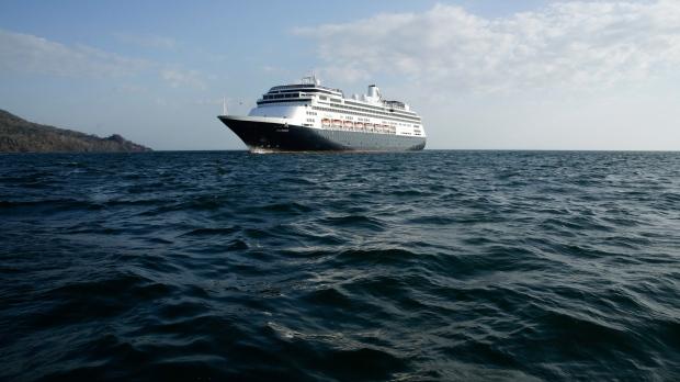 The Zaandam cruise ship is anchored in the bay of Panama City, Friday, March 27, 2020. (AP Photo/Arnulfo Franco)