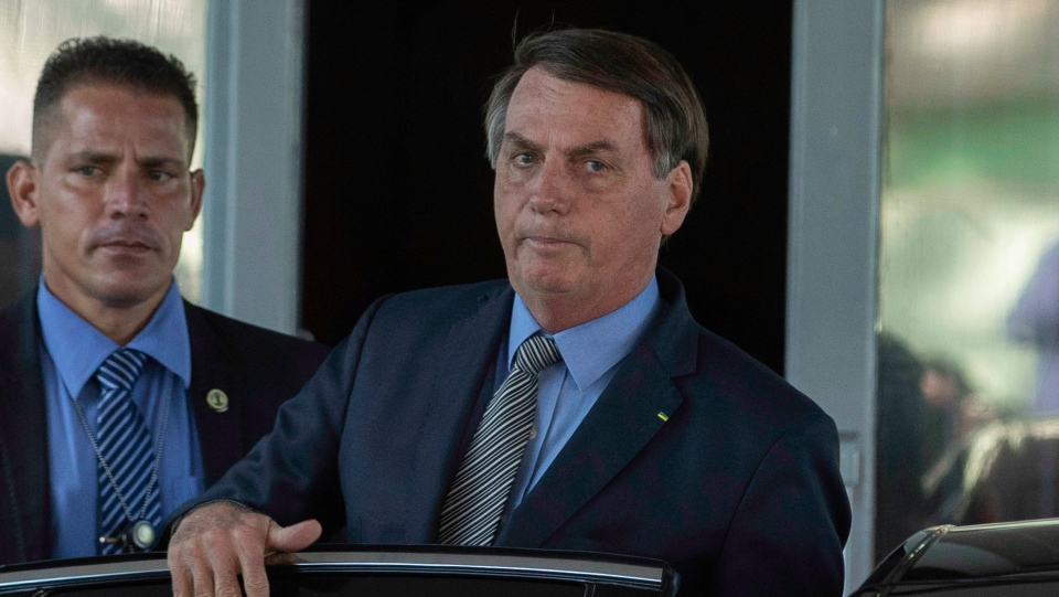 President Jair Bolsonaro leaves the headquarters of the Ministry of Economy in Brasilia, Brazil on Mar. 16, 2020. Even with recommendations to remain in isolation, the president had meetings with Minister Paulo Guedes. (Photo: Bruno Rocha/Fotoarena/Sipa USA)(Sipa via AP Images)