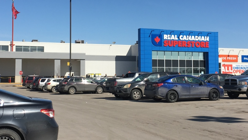 A line formed outside the Polo Park location of the Real Canadian Superstore as it limited the number of customers allowed to enter. (Source: CTV News/Zach Kitchen)