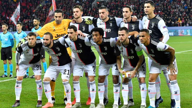 Juventus team players pose prior to the start of the Champions League Group D soccer match against Bayer Leverkusen, on Dec. 11, 2019. (Martin Meissner / AP)