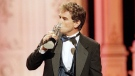In this Friday, Feb. 27, 1998 file photo, John Callahan of 'All My Children' kisses his award after winning Outstanding Lead Actor at the Soap Opera Digest Awards in Universal City, Calif. (AP Photo/Rene Macura)