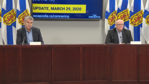 Premier Stephen McNeil and Dr. Robert Strang, Nova Scotia's chief medical officer of health, speak at a news conference on Sunday, March 29.