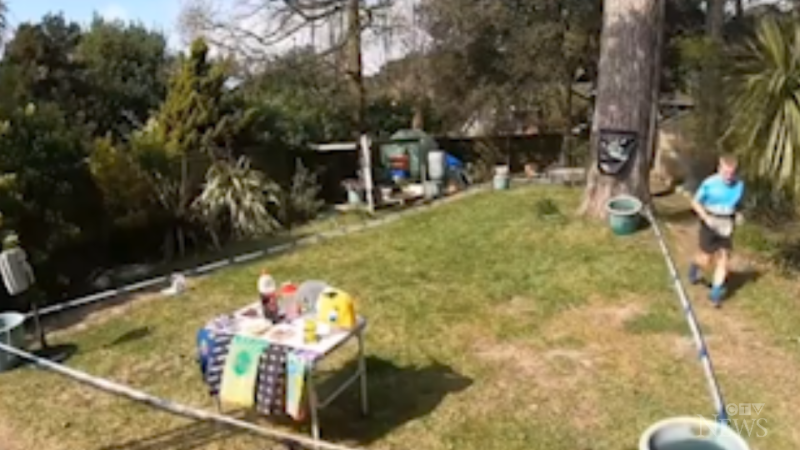 A screenshot from the livestream set up in the backyard of Gareth Allen's home in Southampton, England, showing him running a full marathon around a makeshift track. (Credit: Gareth Allen via Storyful)