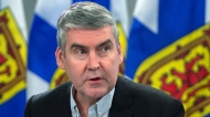 Premier Stephen McNeil attends a briefing as they announce two more presumptive cases of COVID-19 in Nova Scotia, in Halifax on Tuesday, March 17, 2020.THE CANADIAN PRESS/Andrew Vaughan