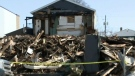 One dead, more than 50 displaced by C.B. fires