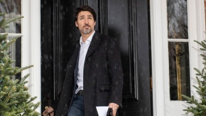 Prime Minister Justin Trudeau looks up at the falling rain as he walks out his front door for his daily press conference on COVID-19 in front of his residence at Rideau Cottage, on the grounds of Rideau Hall in Ottawa, on Sunday, March 29, 2020. THE CANADIAN PRESS/Justin Tang