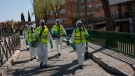 Spanish Royal Guard soldiers disinfect a hospital to prevent the spread of the new coronavirus in Madrid, Spain, Sunday, March 29, 2020. Spain and Italy demanded more European help as they fight still-surging coronavirus infections amid the continent's worst crisis since World War II. The new coronavirus causes mild or moderate symptoms for most people, but for some, especially older adults and people with existing health problems, it can cause more severe illness or death. (AP Photo/Bernat Armangue)