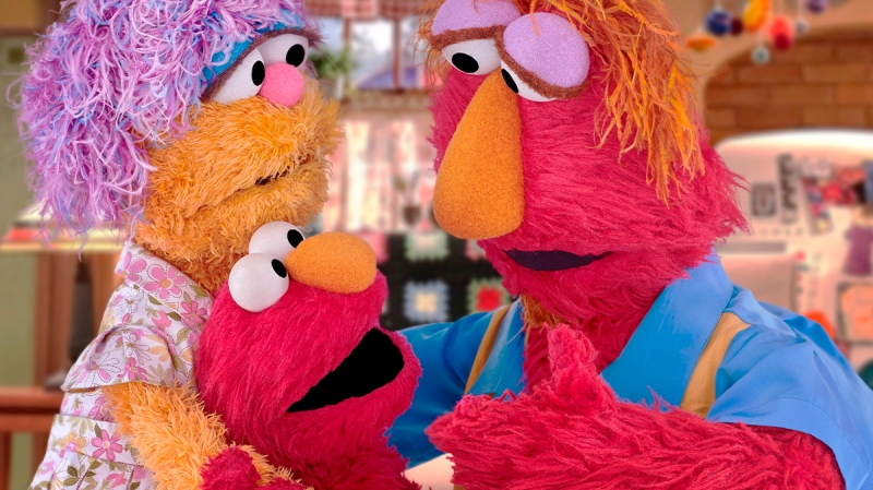 This undated image provided by Sesame Workshop shows Elmo and his parents Louie and Mae. (Sesame Workshop via AP)