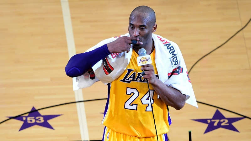 The towel that basketball legend Kobe Bryant draped over his shoulders during his farewell speech in 2016, along with tickets to Bryant's final game, sold at a virtual auction on Sunday for over US$30,000. (FREDERIC J. BROWN/AFP/Getty Images)