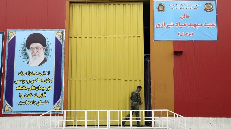 A member of the Iranian Army works at a temporary hospital in Tehran, Iran, Thursday, March 26, 2020. (AP Photo/Ebrahim Noroozi)