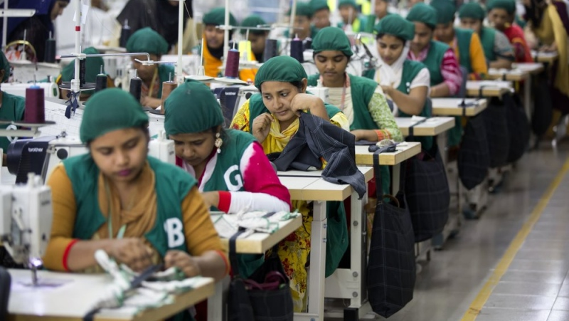 FILE - In this April 19, 2018 file photo, trainees work at Snowtex garment factory in Dhamrai, near Dhaka, Bangladesh. (AP Photo/A.M. Ahad, File)