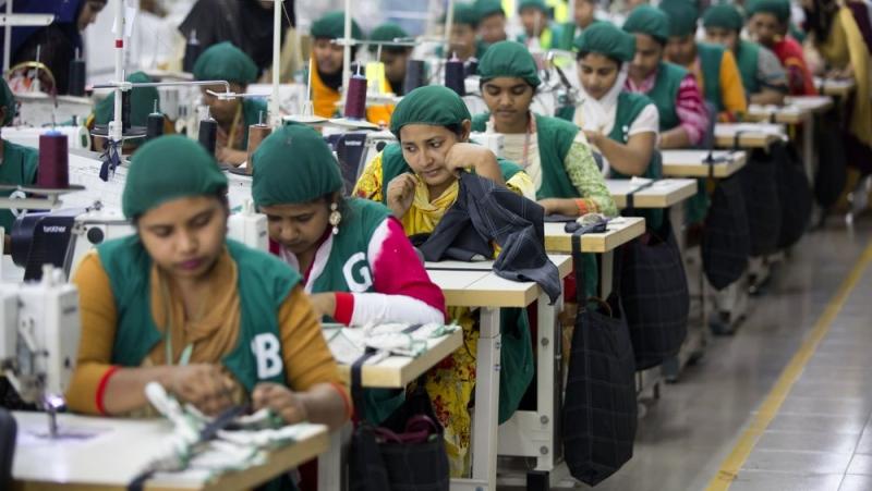 FILE - In this April 19, 2018 file photo, trainees work at Snowtex garment factory in Dhamrai, near Dhaka, Bangladesh. (AP Photo/A.M. Ahad, File)