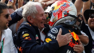 Red Bull driver Max Verstappen, right, celebrates with Helmut Marko during the Brazilian Formula One Grand Prix on Nov. 17, 2019. (Nelson Antoine / AP)