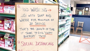 A sign with hand-washing tips and other advice at a pharmacy inside a Saskatoon grocery store on March, 27 2020.