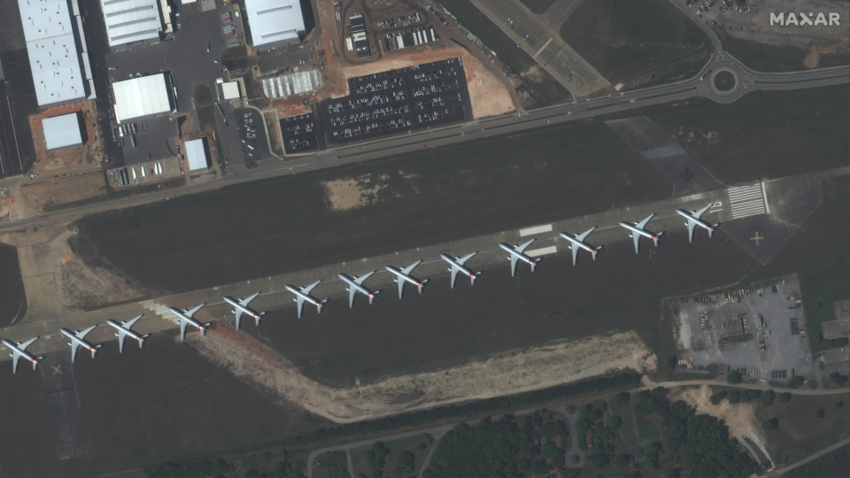 Parked planes are pictured at the Mobile Regional Airport. (Photo: Maxar)