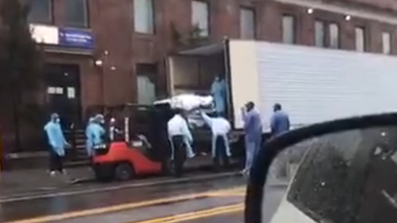 Online video footage from New York City appeared to show a truck waiting outside a Brooklyn hospital for bodies. (Photo: John Lee via Storyful)