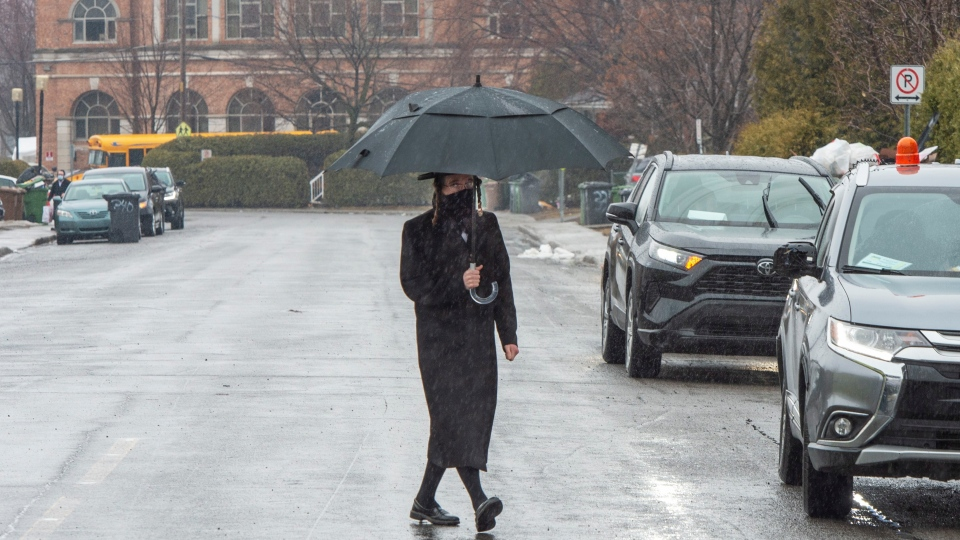 A member of the Tosh de Boisbriand community crosses the street Monday, March 30, 2020 in Boisbriand, Que. north of Montreal. Quebec public health authorities have placed the community of around 4,000 orthodox Jews in the Laurentians under quarantine after a number of members tested positive for COVID-19.THE CANADIAN PRESS/Ryan Remiorz