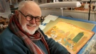 In this photo taken Sunday Dec. 1, 2013, Tomie dePaola poses with his artwork in his studio in New London, N.H. (AP Photo/Jim Cole, File)