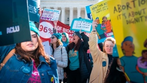 Demonstrators shout slogans and hold banners in an abortion rights rally outside of the Supreme Court as the justices hear oral arguments in the June Medical Services v. Russo case on March 4, 2020 in Washington, DC. (Sarah Silbiger/Getty Images)