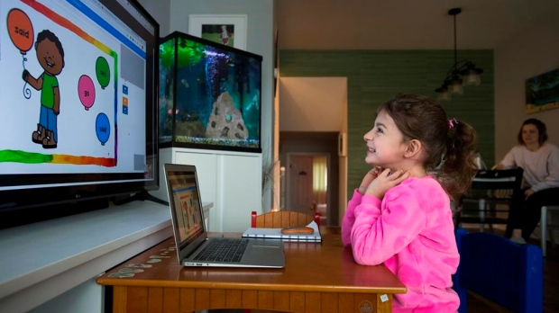 Six-year-old Peyton Denette works on her speech and language skills with speech-language pathologist Olivia Chiu of Two Can Talk remotely from her home in Mississauga, Ont., on Monday, March 30, 2020. Nathan Denette / THE CANADIAN PRESS