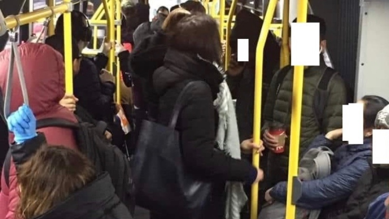Commuters are shown on the TTC's Dufferin bus on Tuesday morning. (Submitted)
