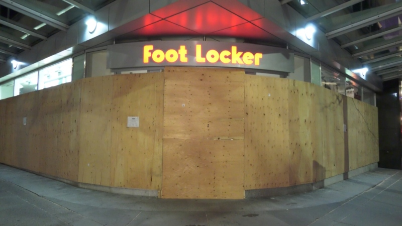 A store in downtown Vancouver is seen boarded up on March 30, 2020.
