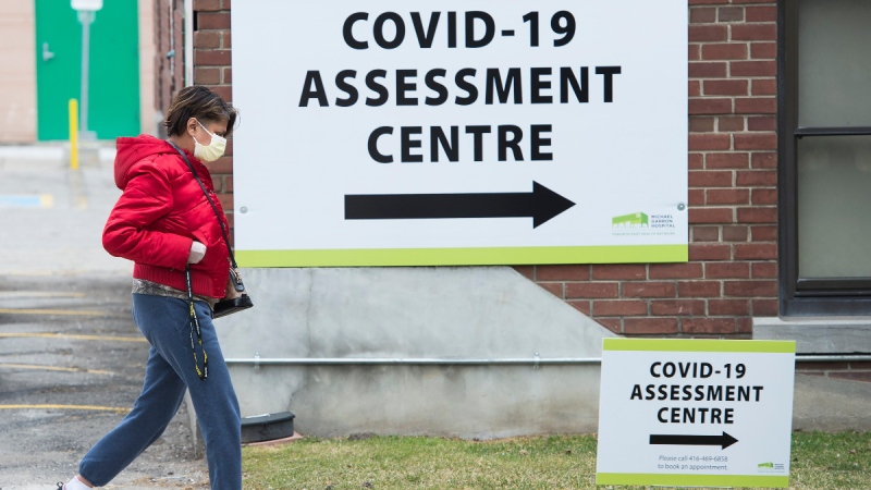 A woman arrives at the Covid-19 assessment centre at the Michael Garron Hospital in Toronto on March 24, 2020. (Nathan Denette / THE CANADIAN PRESS)
