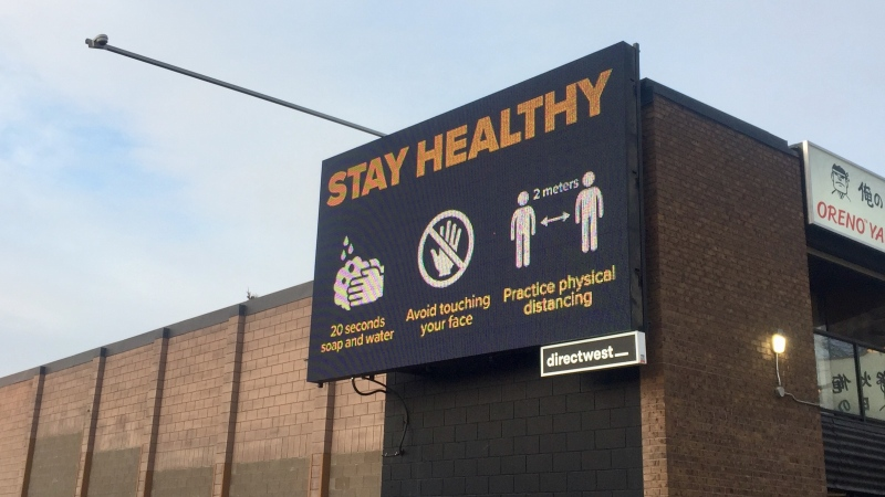 A sign near the intersection of 8th Street East and Broadway Avenue.
