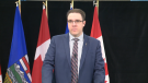 Government House Leader Jason Nixon speaks to media on March 31 about government plans to propose legislation that would protect renters from retroactive charges after the pandemic.