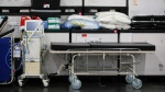 This Monday, March 23, 2020, file photo shows medical supplies and a stretcher displayed before a news conference at the Jacob Javits Center in New York. (AP Photo/John Minchillo, Fle)